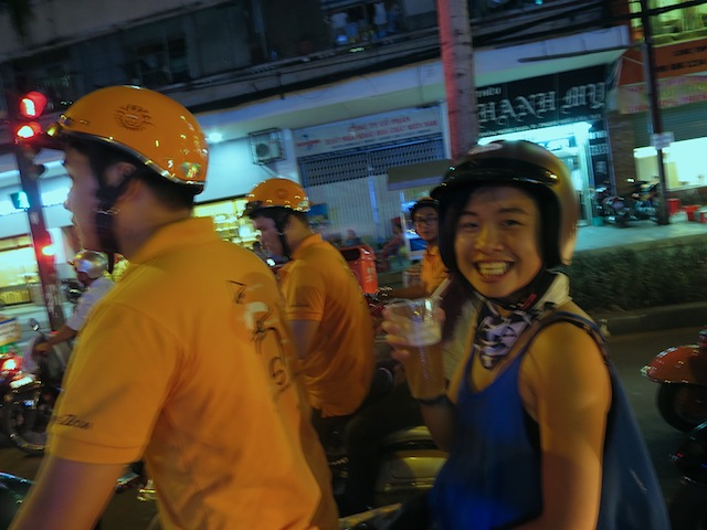Touring the city on a Vespa with a beer in my hand. I love Ho Chi Minh City!