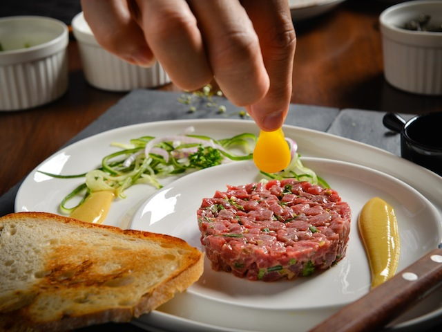 Beef tartare topped with quail egg