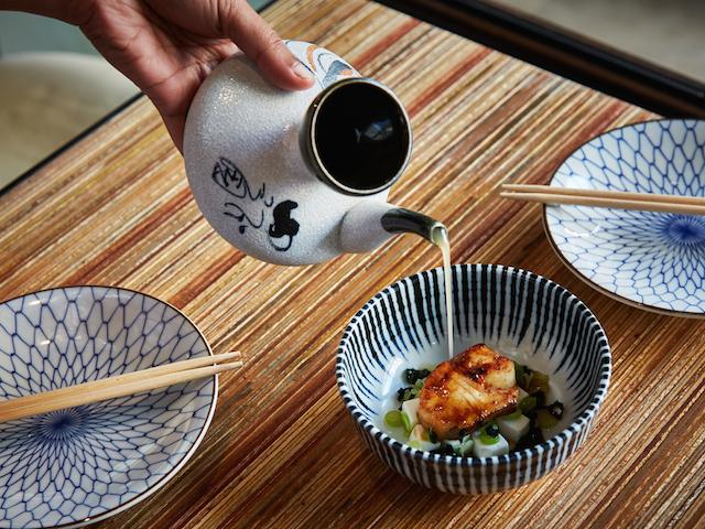 Neon Pigeon'smiso black cod soup comes with smoked dashi and seaweed