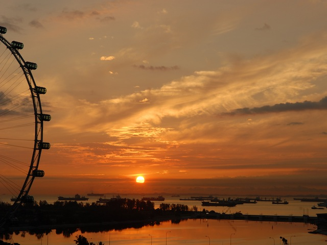 Catch the sunrise from Singapore Flyer (Credits: Tedd Okano Flickr)