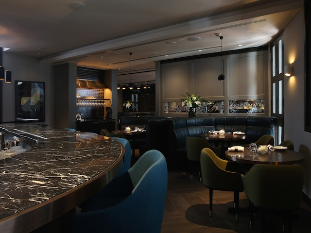 The black marble-topped bar at The Disgruntled Chef on Ann Siang Road, Singapore