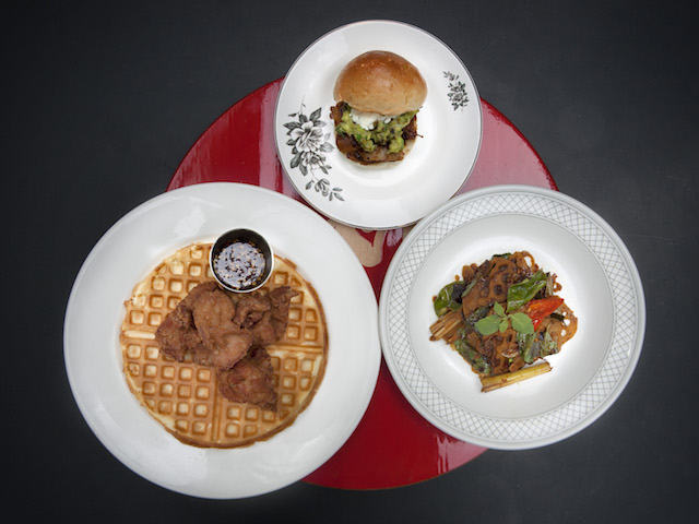 Clockwise from left: Prawn paste chicken and waffles; BBQ braised jackfruit sliders with guacamole and pistachio nuts; sliced lotus roots sauteed with chili jam, dried shrimp, lemon grass, kaffir lime leaf and Thai basil