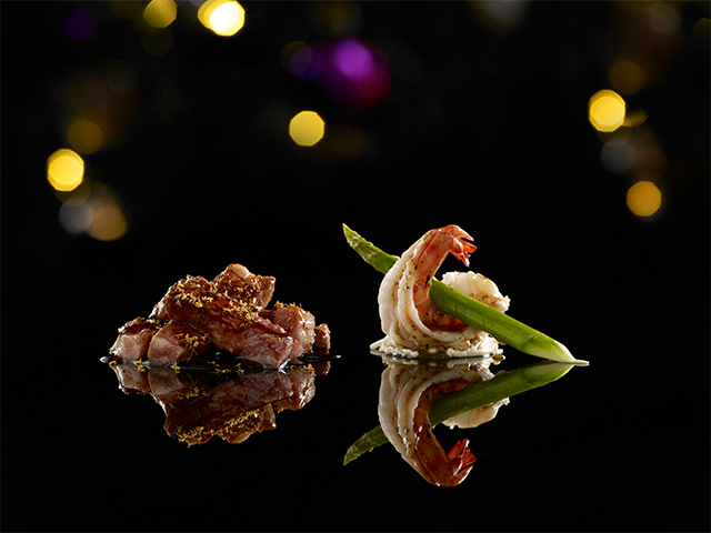 Pan fried truffles king prawn in asparagus skewer with osmanthus wagyu beef by Mitzo