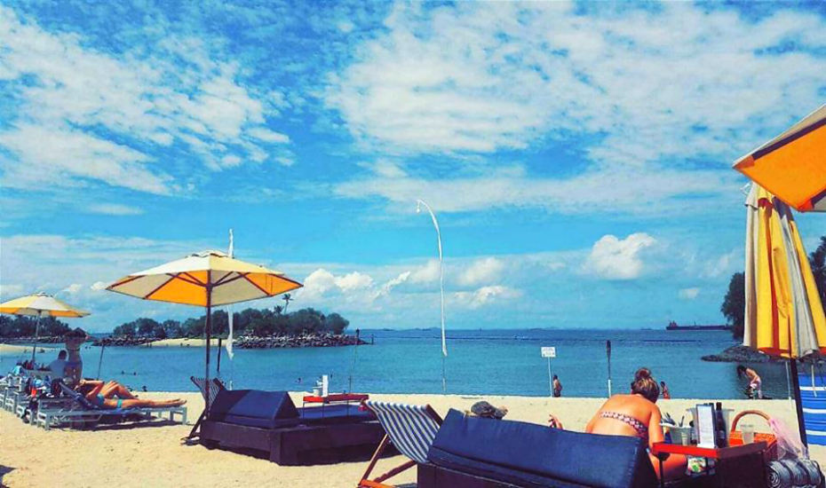Spend your afternoon lazing at Siloso beach, or join the plethora of activities happening 'round the island (Credits: Sentosa)