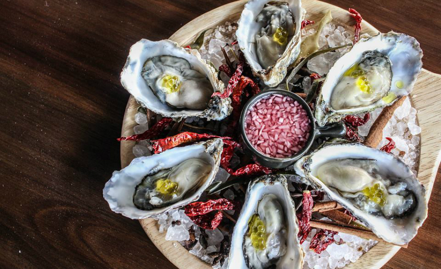 Down some glasses of wine while slurping some oysters? Don't mind if we do; Angie's Oyster Bar is back!