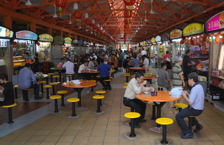 It's hardly the fanciest of places, but you'll find the best food at our local hawker centres (Credit: Flickr/ Aapo Haapanen)