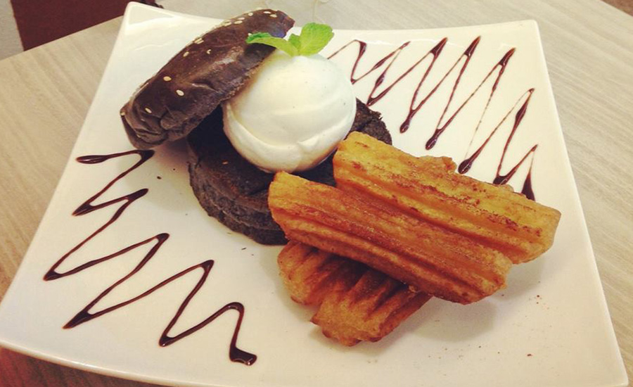 Enjoy the cottage burger with churros that comes with a scoop of ice cream at Bell's Cottage Café