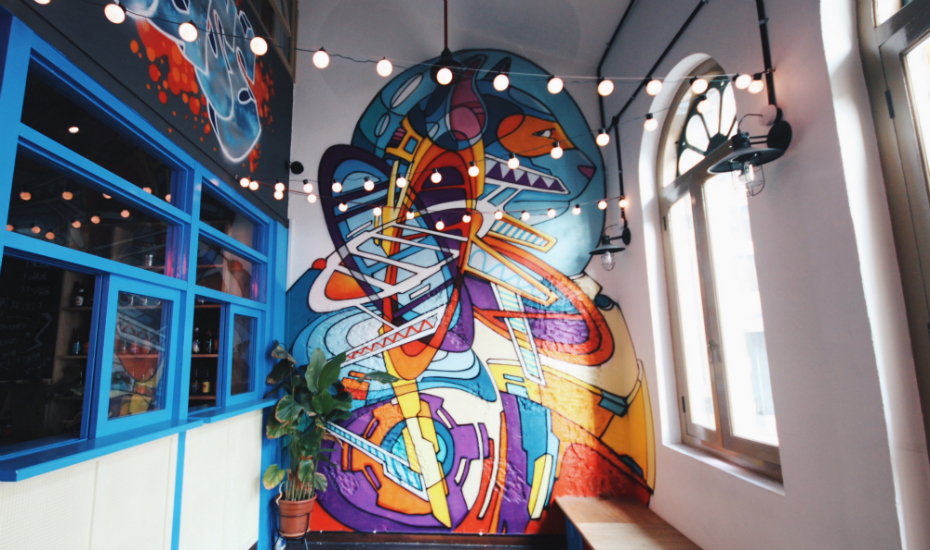 Freehouse's interior is decked out with quirky wall art and fairy lights (Photo credit: Freehouse)