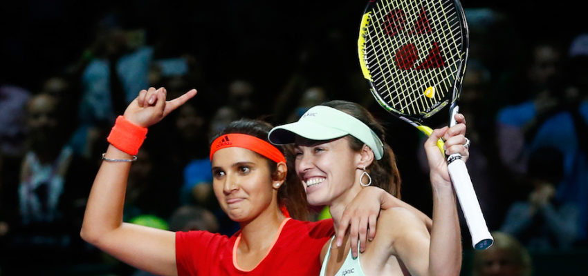 Sania Mirza of India and Martina Hingis of Switzerland  celebrate defeating Carla Suarez Navarro and Garbine Muguruza of Spain in the doubles final match during the BNP Paribas WTA Finals at Singapore Sports Hub on November 1, 2015 in Singapore.  (Photo by Julian Finney/Getty Images)
