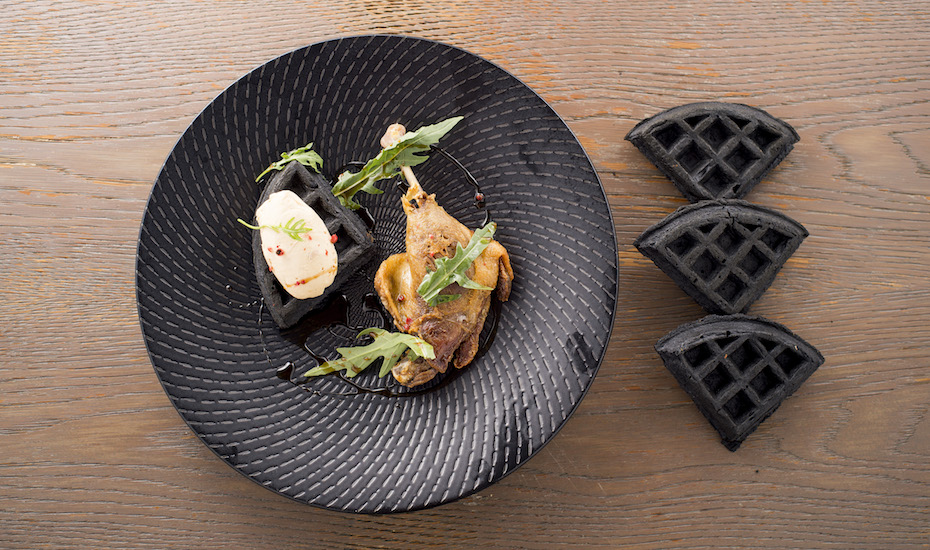 Sink your teeth into the duck and charcoal waffle
