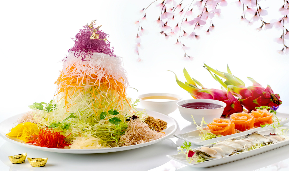 Check out Xin Cuisine's yu sheng with dragon fruit sauce