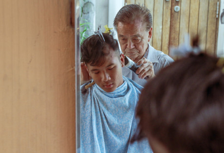 Mr Lee is one of the last streetside barbers