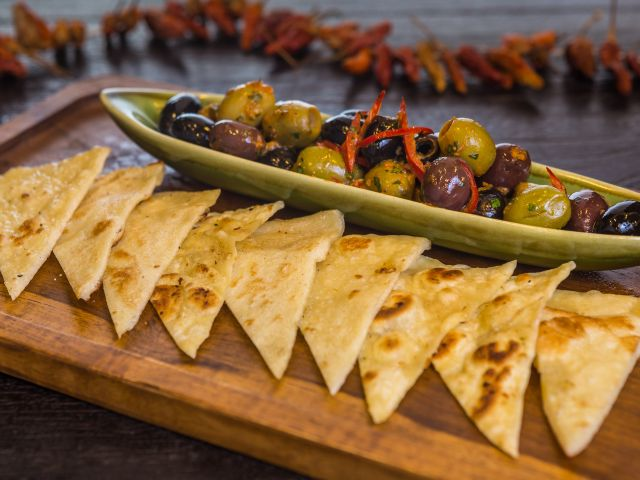 Graze and lounge away, all night long with mezze plates with meat, seafood or vegetarian delicacies