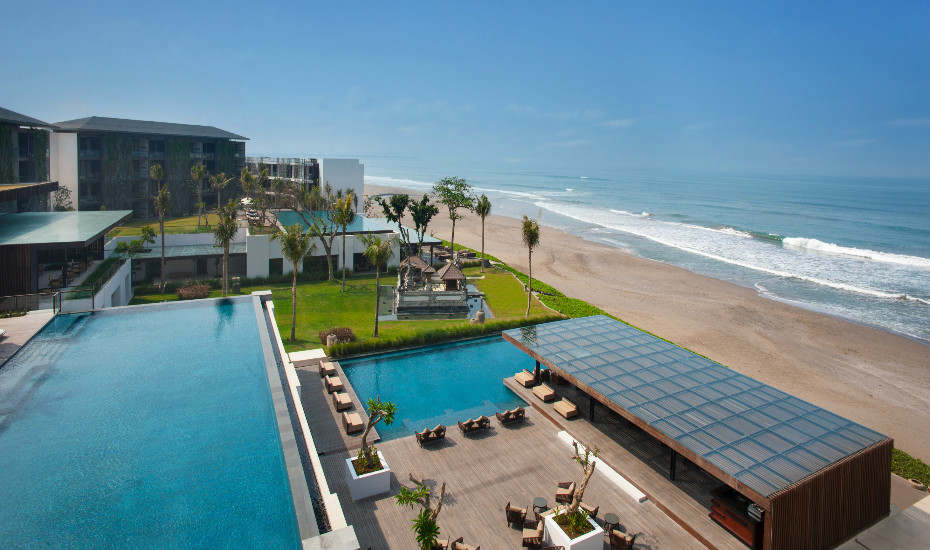 Sip cocktails at the fabulous Alila Seminyak as the sun sets