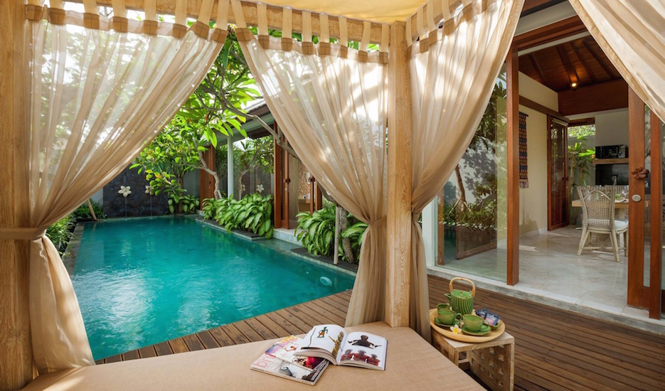 Relax on a day bed by your private pool
