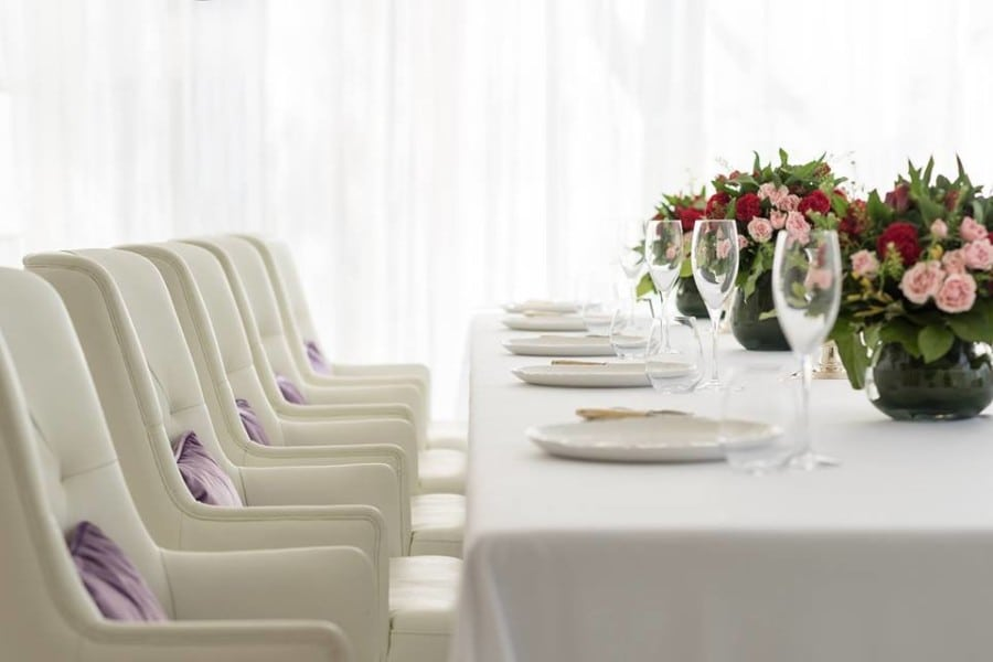 The interior space at Le Pan features white marble  white leather seating  and white tablecloths to create an elegant fine dining settingNew restaurants in Hong Kong  French restaurant Le Pan in Kowloon  . French Fine Dining Table Set Up. Home Design Ideas