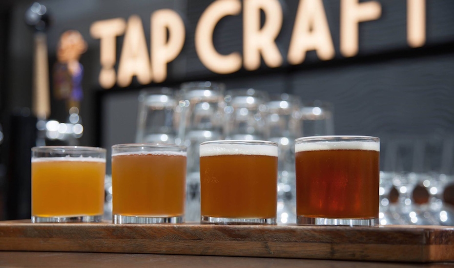 Order a beer paddle and sample several brews at TAP (via Facebook)