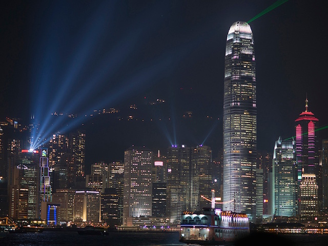 A dazzling laser lightshow plays across the Hong Kong's iconic skyline (Credits: Barbara Willi)