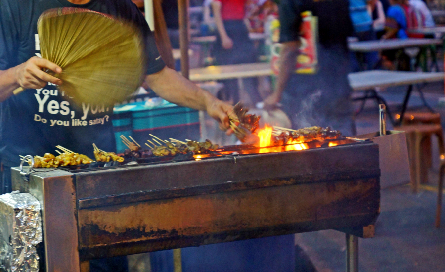 an experience of satay a malaysian national snack Penang food writer helen ong distinguishes malaysian satay by its peanut-based sweet and slightly piquant sauce and the meats marinated with local spices nasi lemak.