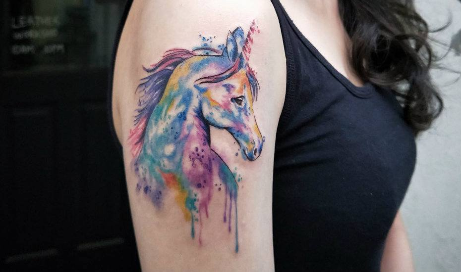 Tattoo studios in Singapore: Visual Orgasm unicorn design