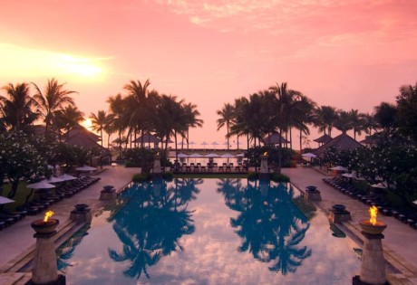Conrad Bali's main swimming pool at sunrise.
