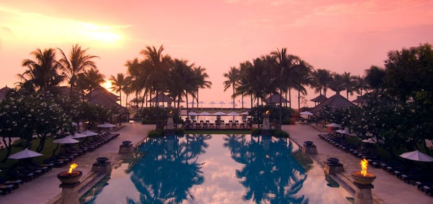 Conrad Bali's main swimming pool at sunrise.
