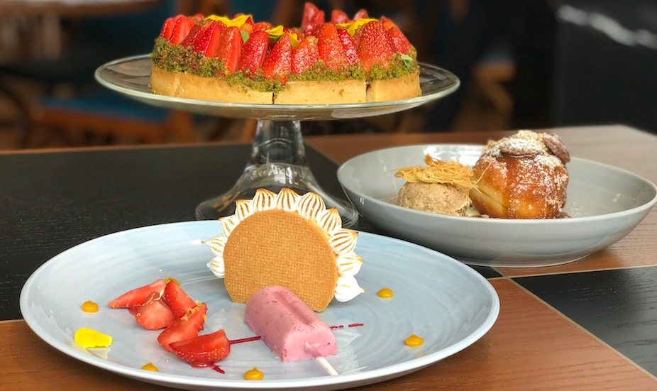 Strawberry and pistachio tart, yuzu and lemon tart and brioche donut with coffee ice cream at Origin grill and bar