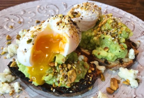 Poached eggs and smashed avocado get an upgrade on Firebake's woodfired sourdough toast.