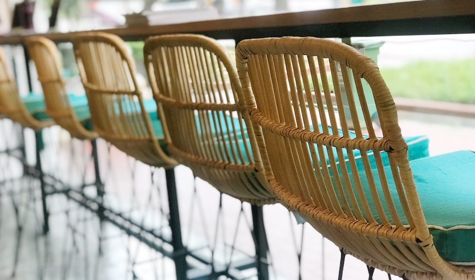 Rattan chairs and rustic wood bring Bali cafe vibes to The Social Space.