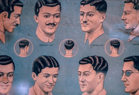 Vintage poster displaying old-school men's hairdos.Men's grooming and best barbers in Singapore: the Honeycombers guide