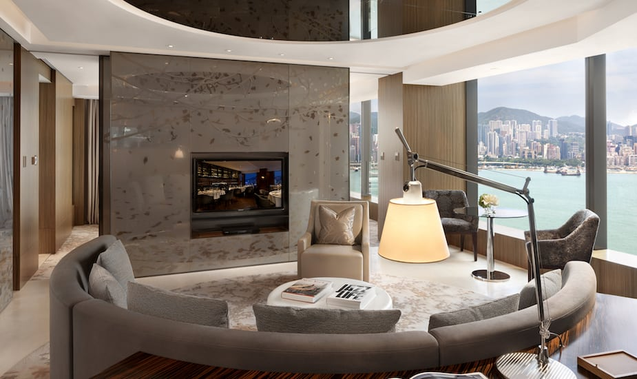 Hotel Icon's Club 80 Suite with a water and skyline view of Hong Kong
