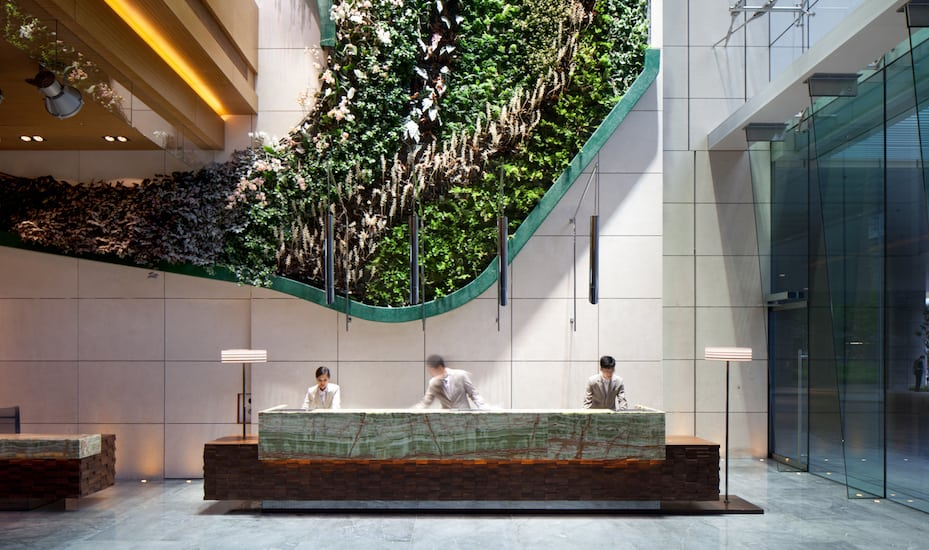 Cool in Kowloon: Hotel Icon's modern lobby with spectacular garden wall feature