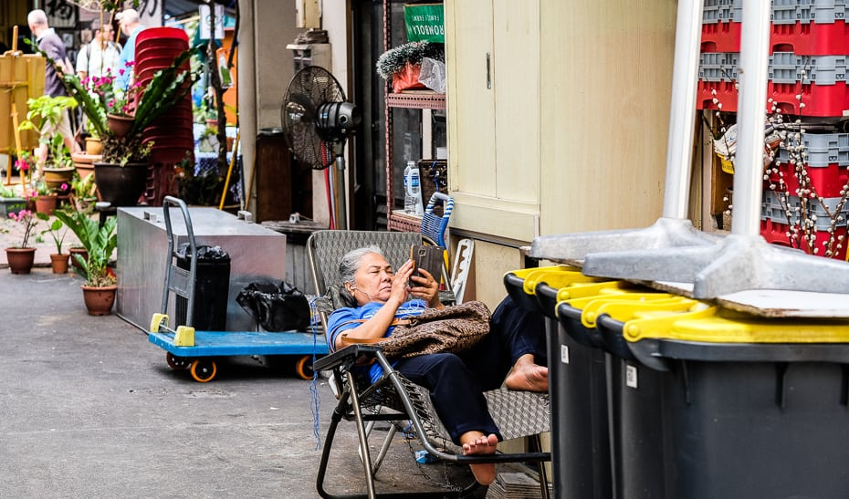 Laneway relaxation in Singapore's Chinatown, photographed by Meera Jane Navaratnam of Asia Photo Collective