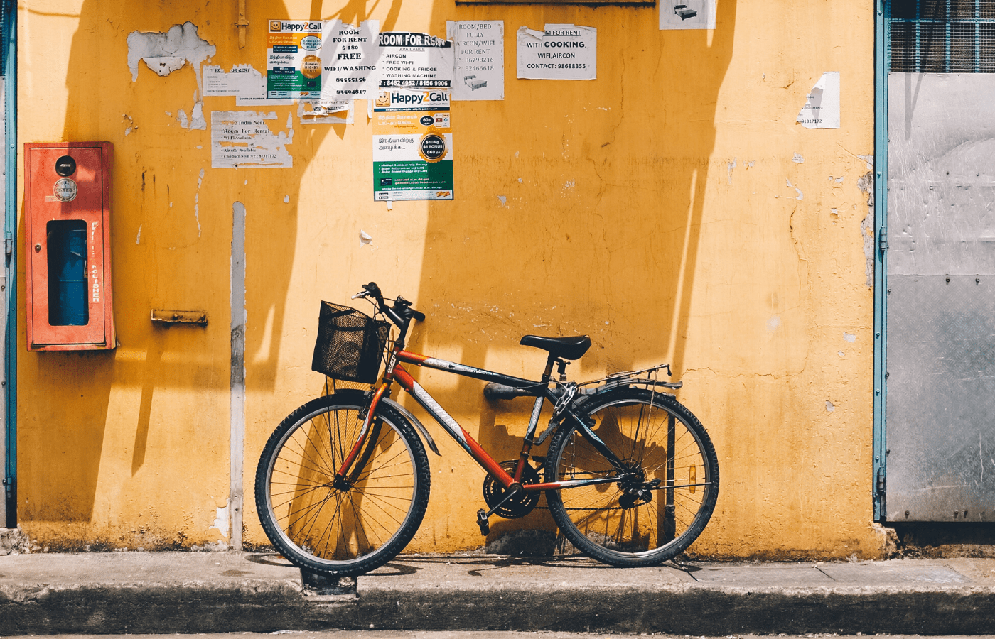 bicycle against yellow wall