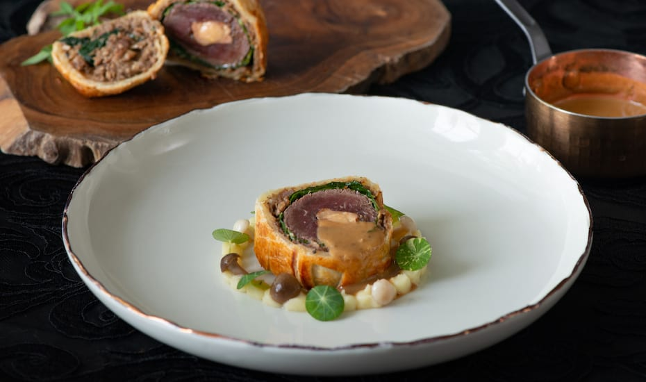 The signature Venison Wellington at Aperitif restaurant