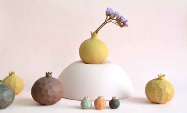 we're also heavily crushing on these pomegranate bud vases from Eat & Co