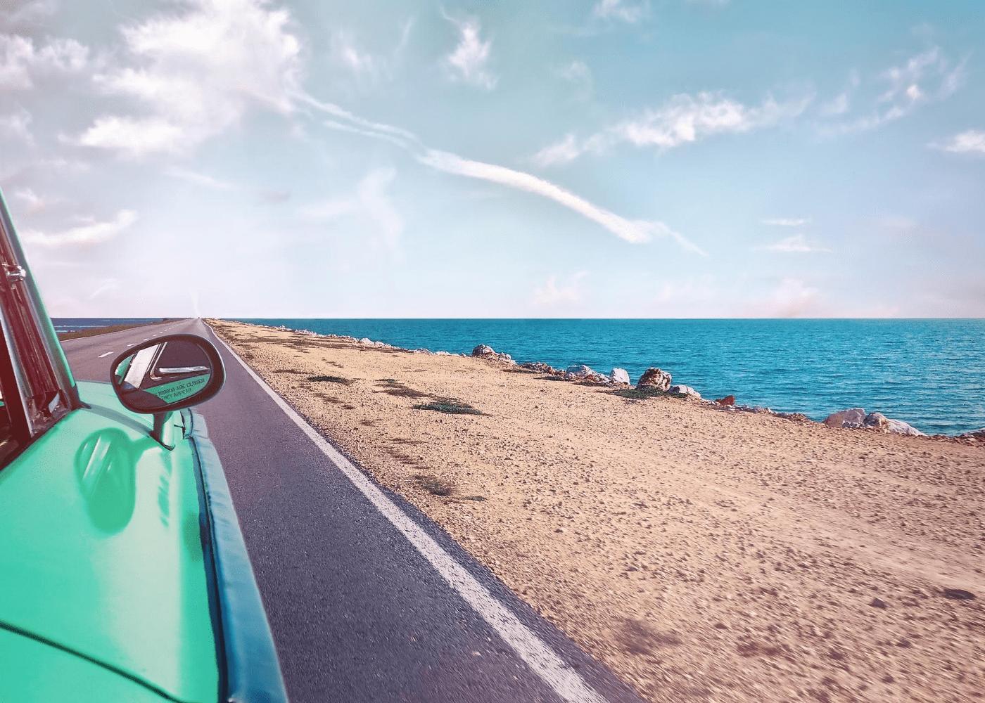 car driving down beach | public holidays 2021