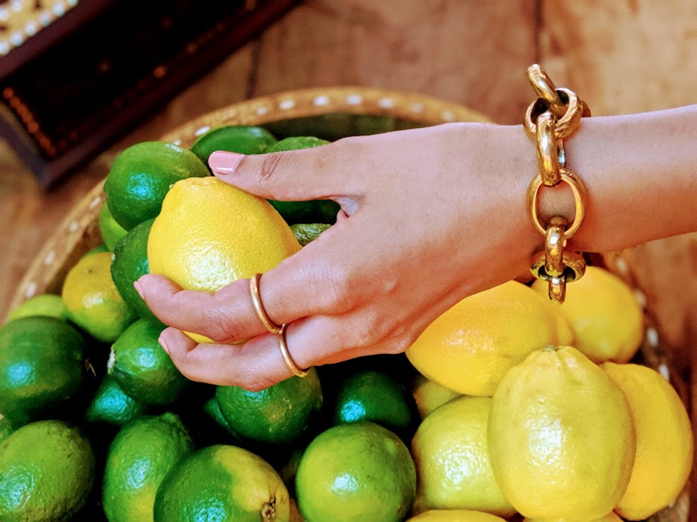 Chetna Bhatt of Ashepa Lifestyle wears the Zulu bracelet and Classic brass rings.