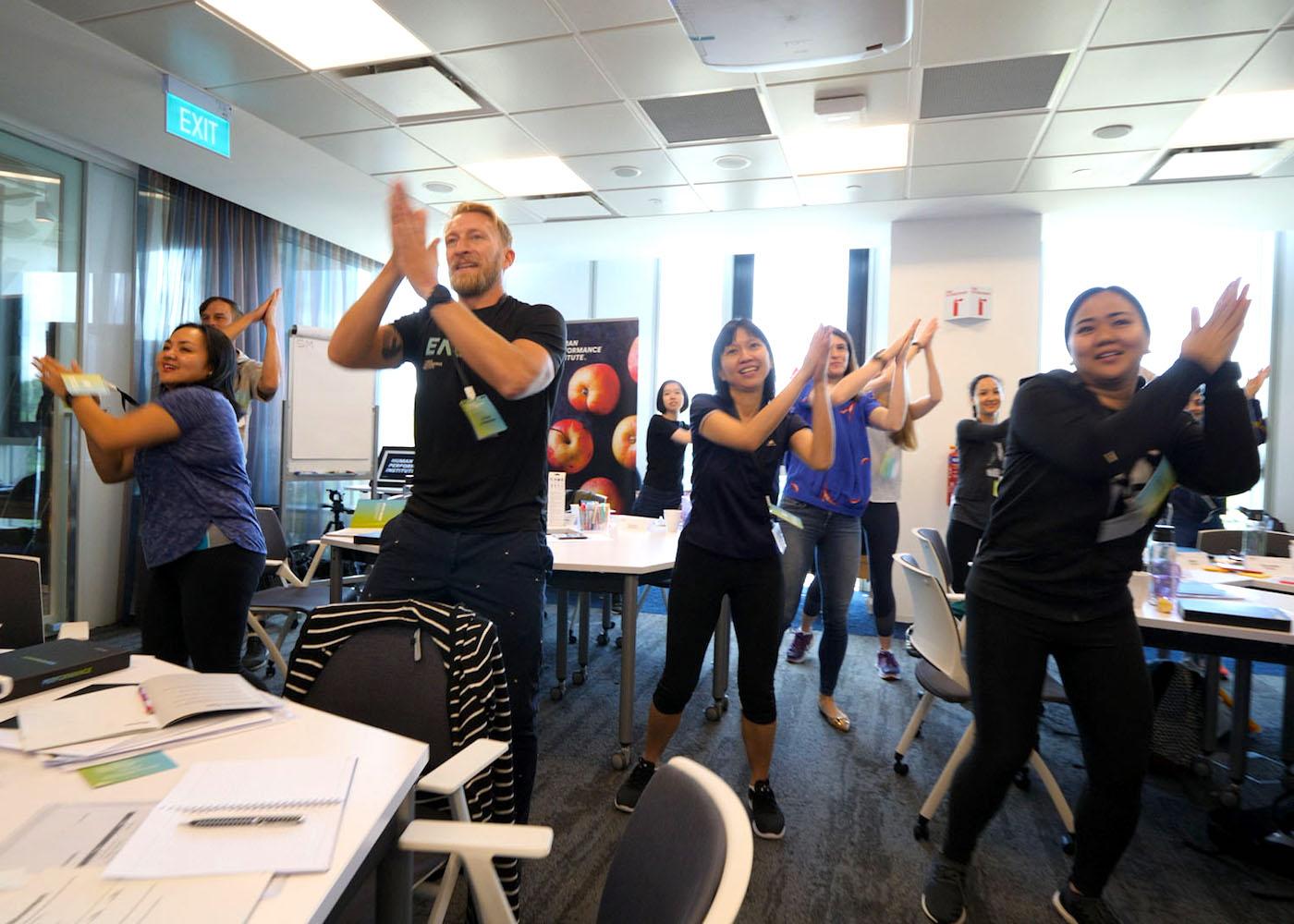Human Performance Institute: Coach Chris McUtchen gets course participants dancing.