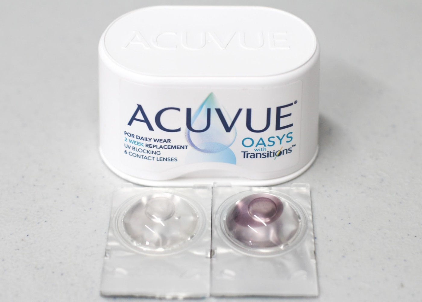 ACUVUE OASYS Contact Lenses With Transitions when it is activated (left) and before it is activated (right).