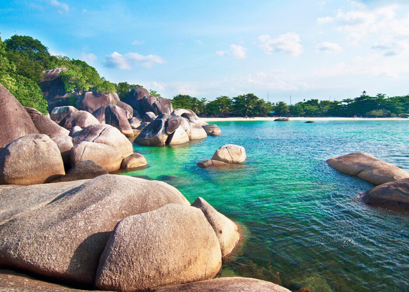 Find these granite stones along Tanjung Tinggi Beach.