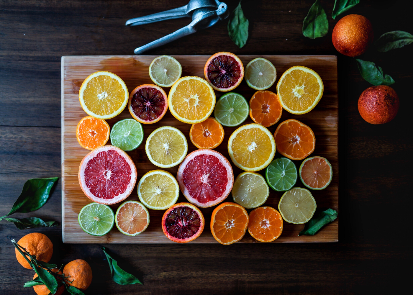 citrus fruits on chopping board