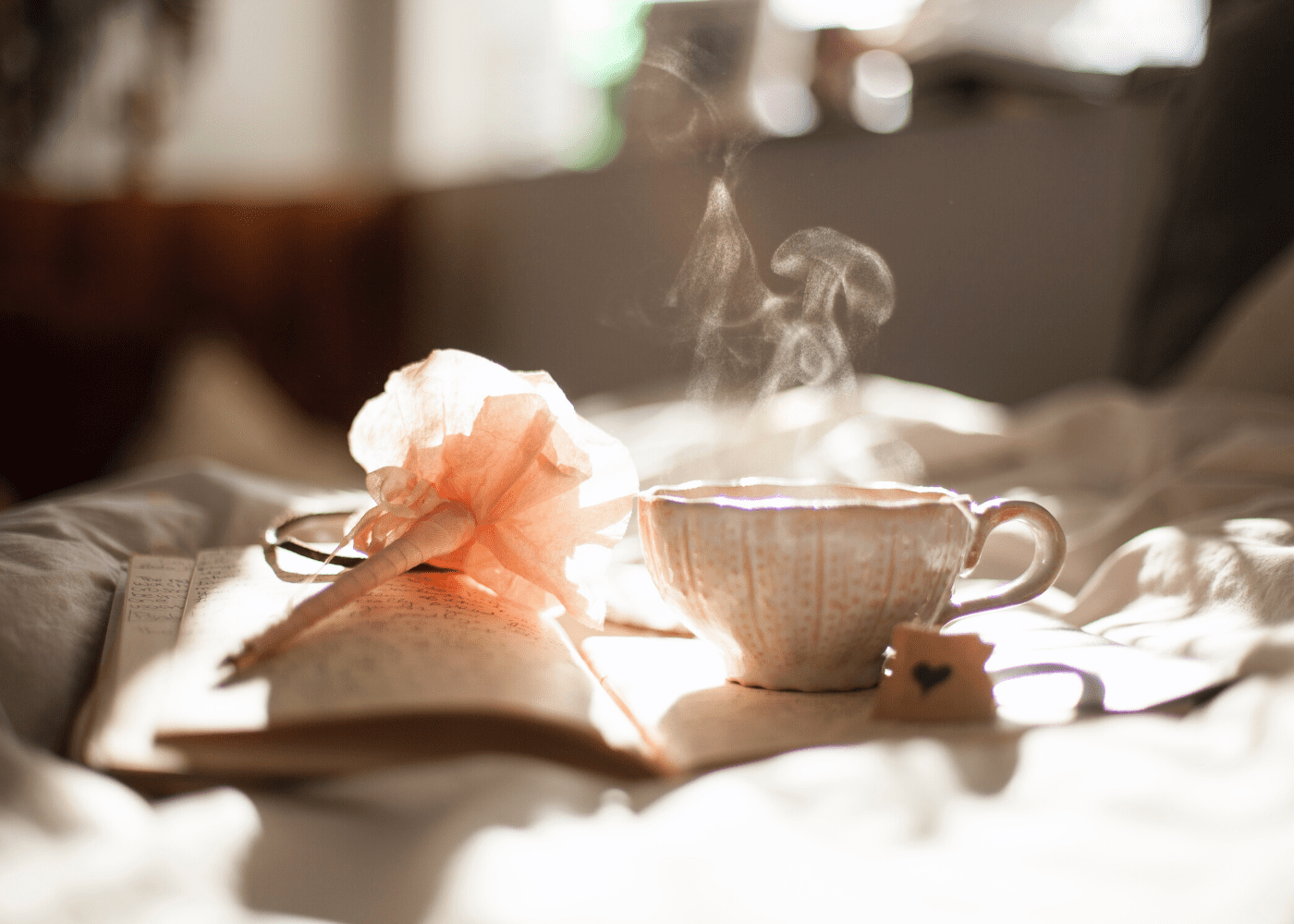 hot tea and a pen and book