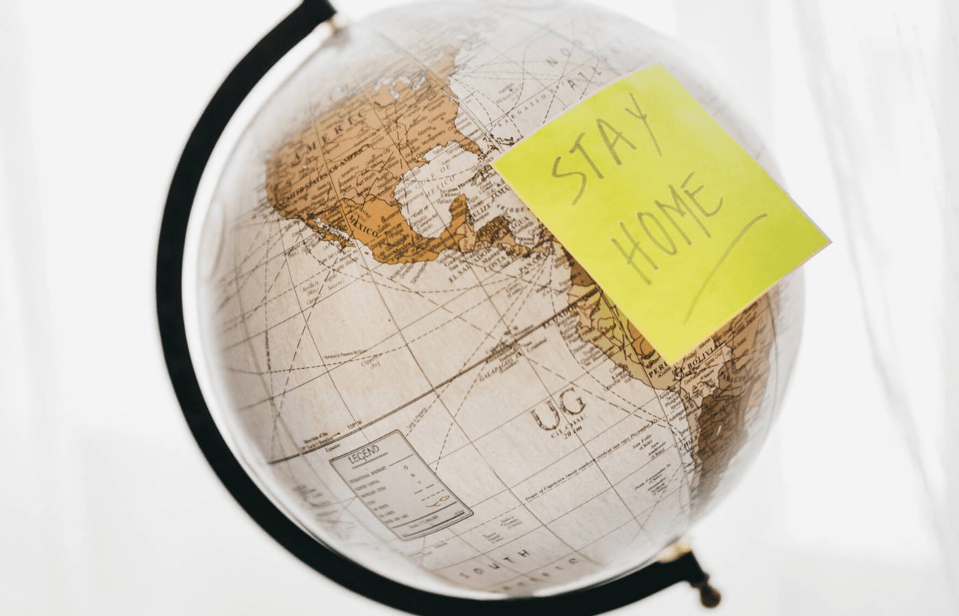 stay home sticky note on world map | covid-19 circuit breaker