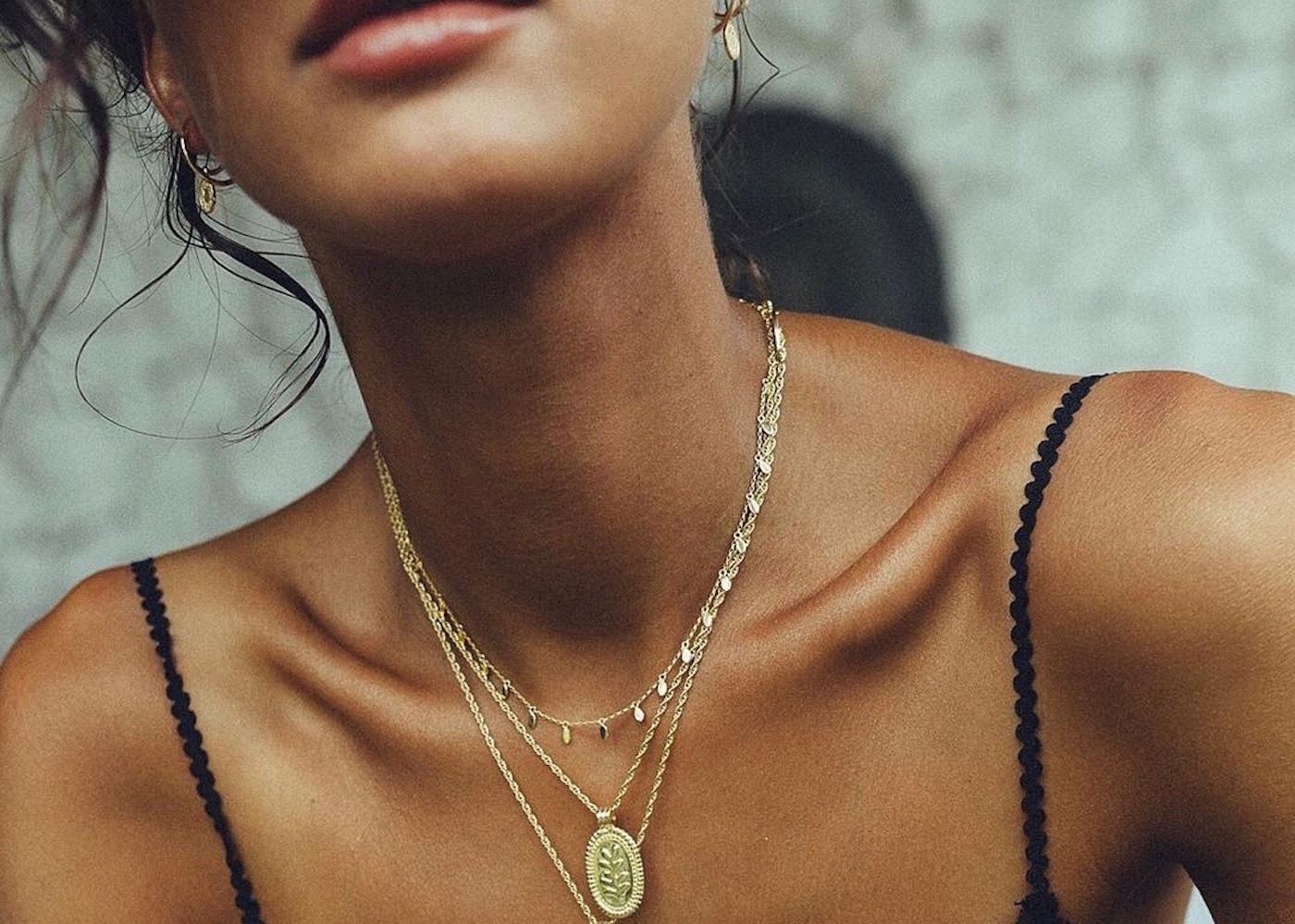 Model wearing Wildthings gold jewellery in Bali, Indonesia