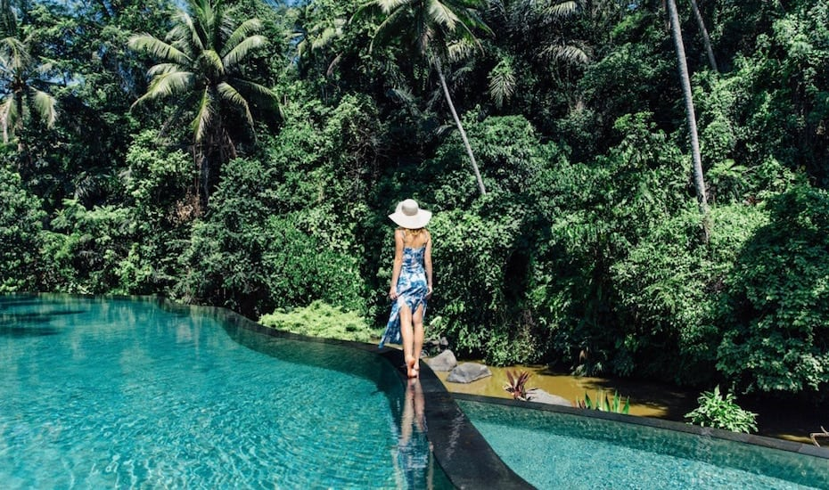 Girl in the jungle infinity pool at Four Seasons Resort Ubud in Bali, Indonesia