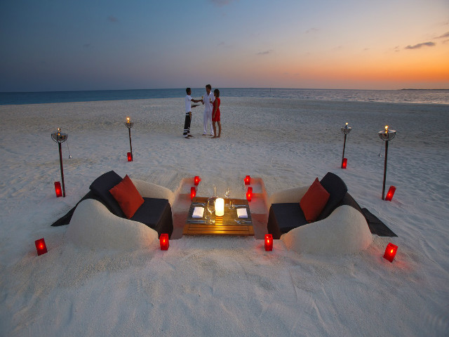 June is the perfect time of year for romantic alfresco dining on the beach