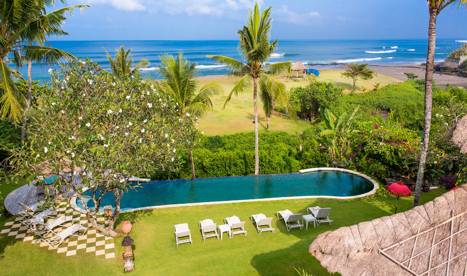 Check in to this authentic Balinese villa with private beach access and infinity pool near Canggu