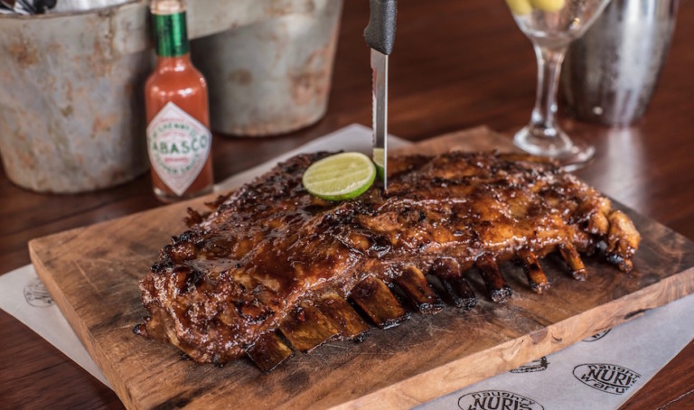 Ribs in Bali: Pig out in Seminyak at the REAL Naughty Nuri's Warung for a lip-smacking rib fix and knock-out martinis.