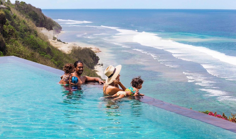 Family in the infinity pool at The Ungasan Clifftop Resort in Uluwatu, Bali - Indonesia